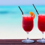 Two tropical cocktails served at beautiful beach